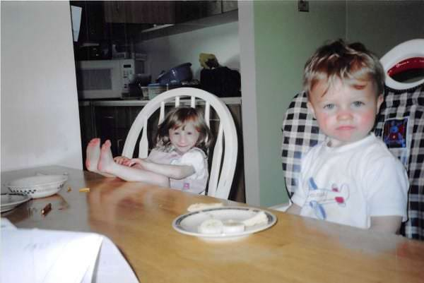 Image #: 40560832    *** EXCLUSIVE - VIDEO AVAILABLE *** *** FILE PHOTO *** KITCHENER, ONTARIO - 2007: Kenadie Jourdin-Bromley at 4-years-old with 2-year-old brother Tyran at the table in their home in Kitchener, Ontario.  AT TWELVE years old tiny Kenadie Jourdin-Bromley stands at just 39.5 inches tall and weighs the same as a two year old. The bubbly schoolgirl has defied doctors since the day she was born weighing just 2.5lbs and 11 inches from head to toe. Kenadie's mum, Brianne Jourdin, 36, was told her daughter wouldn't survive more than a few days. However, despite having learning difficulties and fragile, thin bones - Kenadie plays hockey, swims, and functions in school.  Barcroft Media /Landov