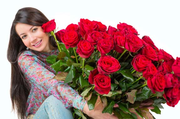 Beautiful woman with a bouquet of red roses
