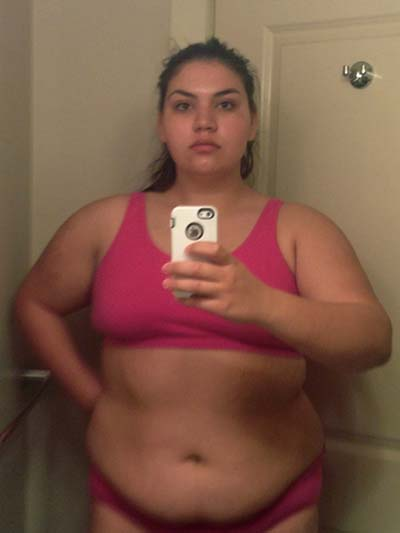 PIC BY IRON GIANTESS / CATERS NEWS - (PICTURED: Laura Micetich before weight loss in 2014) - A stunning woman who shrunk 115lbs after a break-up looked so unrecognisable people thought she had gone under the knife. Laura Micetich, 25, struggled with secretive binge eating and by 2014 she had ballooned to 300lbs. At six-feet and with her obese frame, Laura described herself as intimidating. After the breakdown of a four year relationship, the beautiful brunette decided to get fit. The teacher from Jackson, Tennessee, USA, initially considered weight loss surgery but when she joined a gym and watched the first few pounds fall off she realised she could do it naturally. SEE CATERS COPY